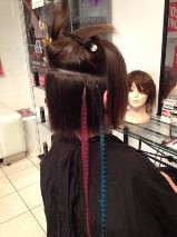 after the stunning 'smashed bob' haircut, grizzly feather extensions are added